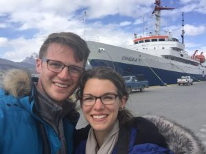 Chelsea and Ryan in front of their ship