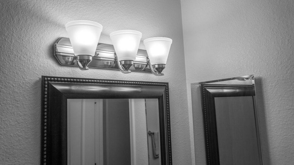 New brushed nickel lighting in guest bathroom