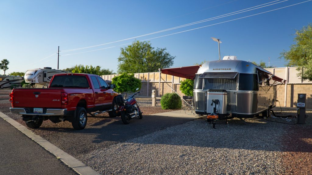 Charlie (Airstream) and Clifford (Truck) w/motorcycle at our camp site