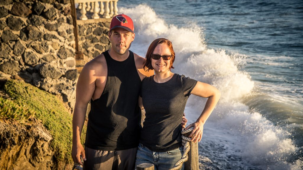 The wife and I in front of crashing waves!