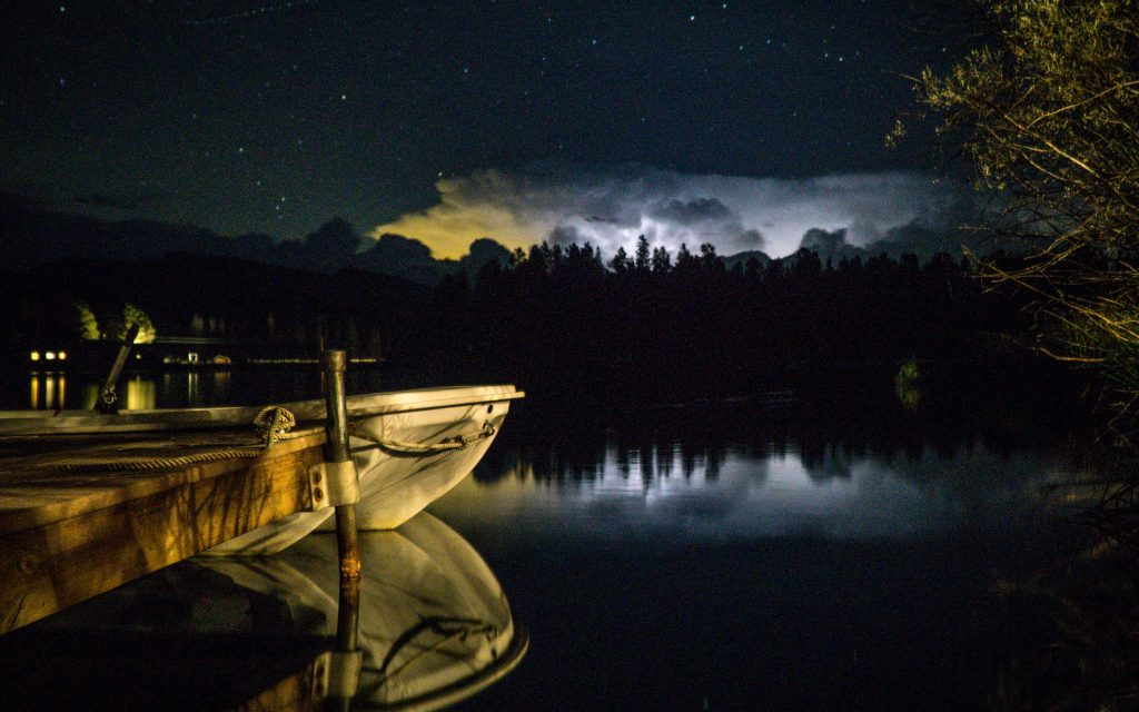 From our dock on a smaller lake, thunderstorms in the distance